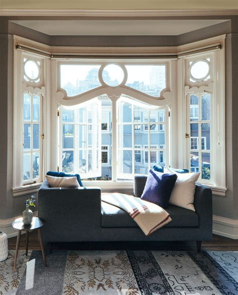 bay window furniture bay window furniture with wood flooring fireplace hearth tv above seat