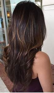 Shiny brunette with hints of balayage highlights ...
