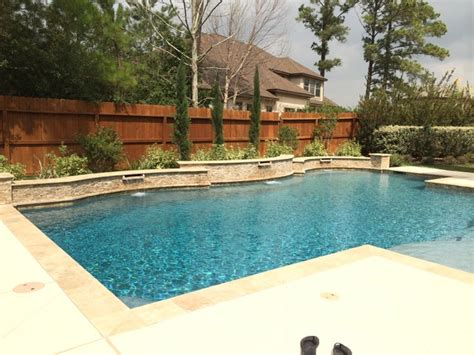 raised pool travertine pool with raised beam wall scuppers traditional landscape houston by great