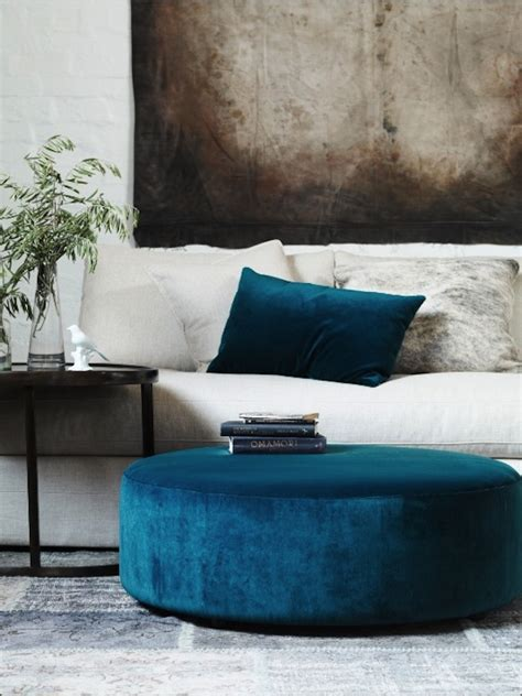 blue tufted ottoman coffee table get the look ottoman as coffee table artisan crafted