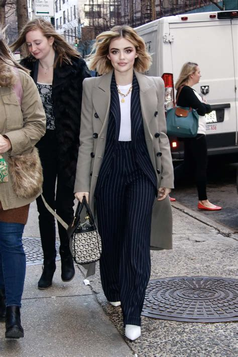lucy hale wears a blue pinstripe suit while visiting ...