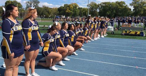 iowa cheerleader  kneeled  national anthem wins