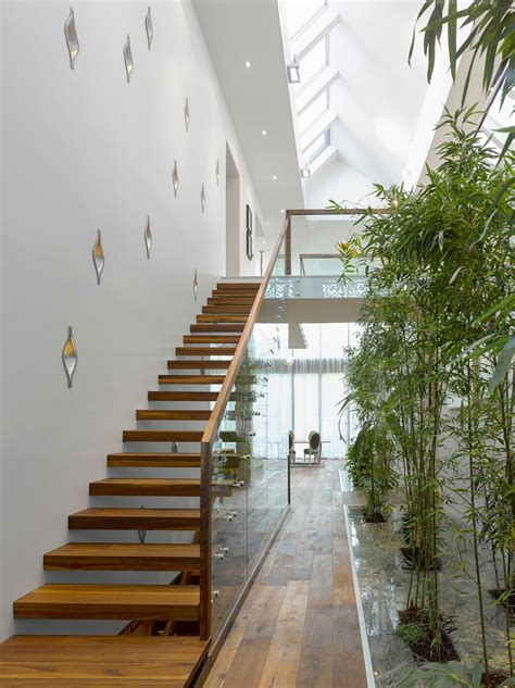 modern custom home  central atrium  interior bamboo garden idesignarch interior