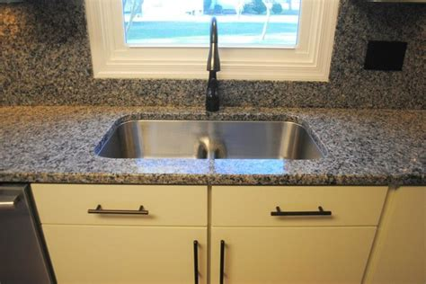 caledonia granite tops and backsplash stainless