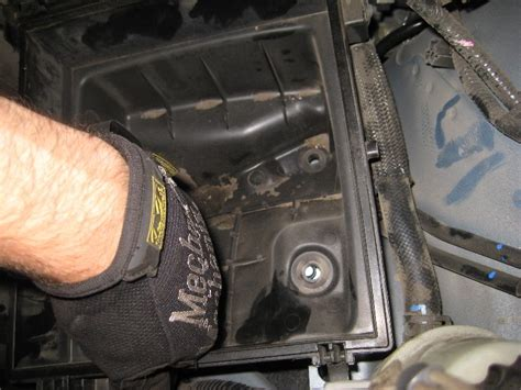 how to change the low beam headlight bulb in a 2013 gmc