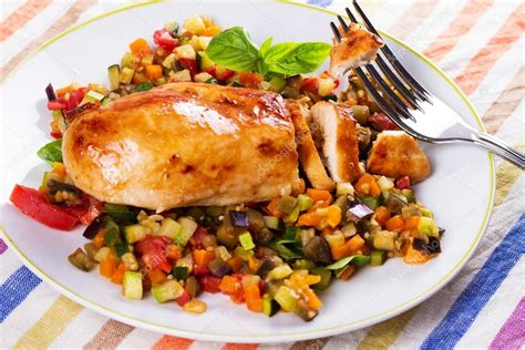 sauteed chicken breast with vegetables fried chicken breast with sauteed vegetables eggplant carrot zucchini squash and tomatoes