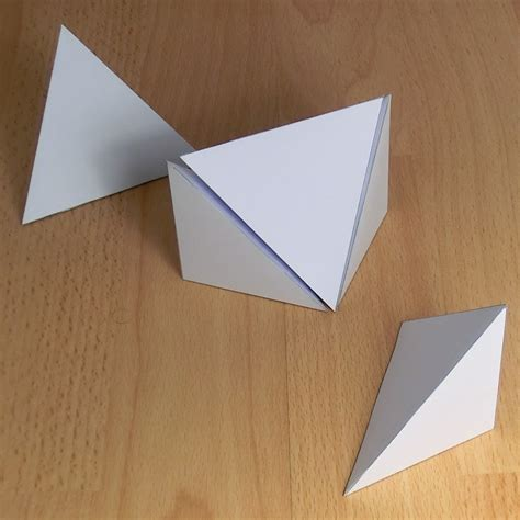 triangular form paper five pyramids that form a cube