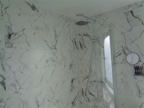 white marble wall luxury bathroom renovation with italian marble effect tiles