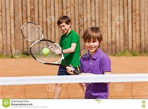 Two Young Tennis Players Waiting For A Ball Stock Photo ...