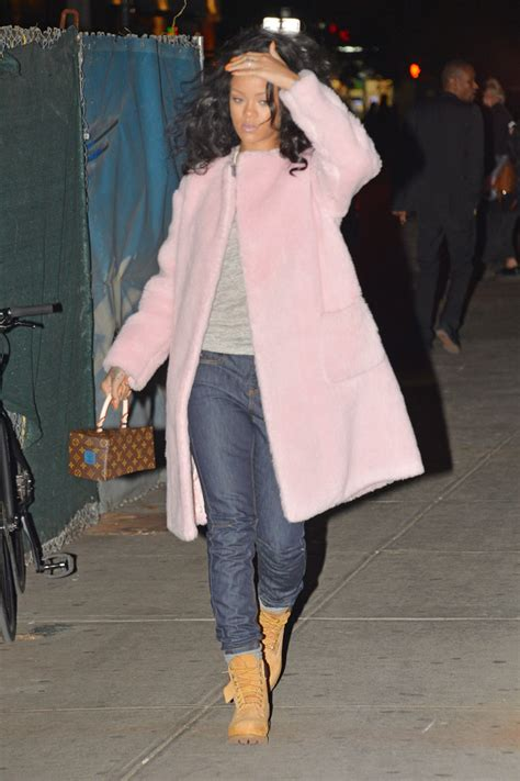 rihanna carries louis vuitton bag designed  franky gehry
