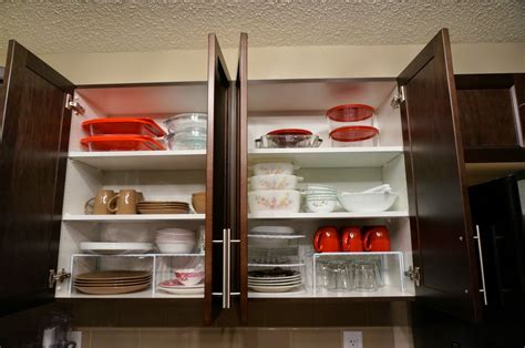 how to organize small kitchen cabinets we love cozy homes how to organize kitchen cabinet shelves