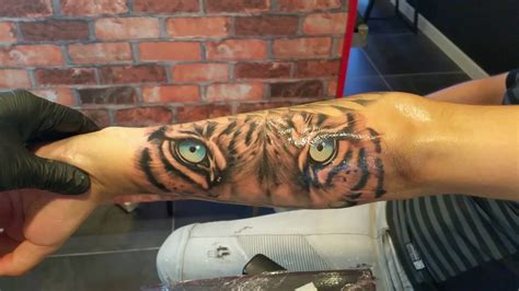 blue tiger eyes tattoo  forearm