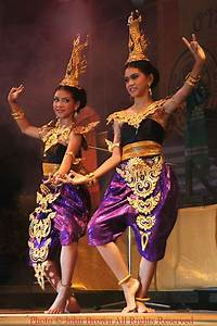 Two young women dancers are wearing traditional Thai costumes at the Krabi Dance Festival in ...