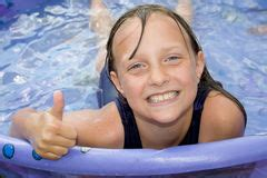 youngster  wading pool royalty  stock photography