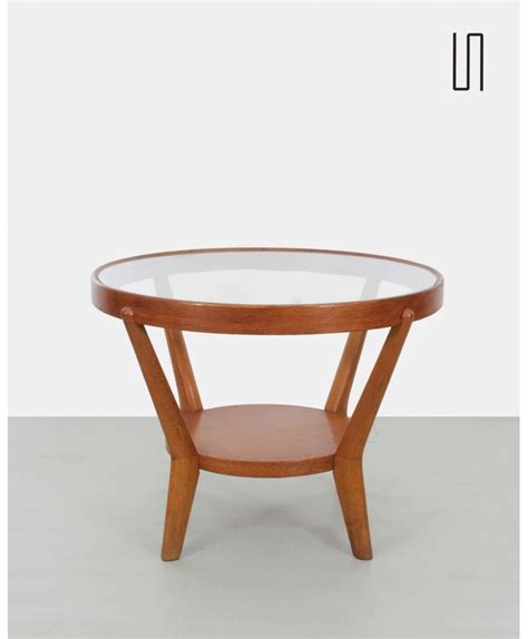 A coffee table is a low table usually placed in front of a sofa used to keep smaller with numerous coffee table styles, sizes, and features to choose from, it's important to consider several important design and construction factors. Eastern European coffee table by Kropacek and Kozelka, 1940s