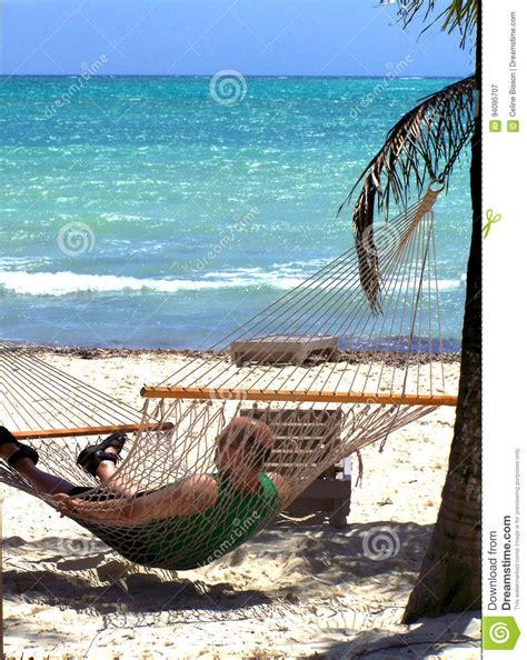 Relaxing On Hammock by Relaxing In Hammock Royalty Free Stock Image