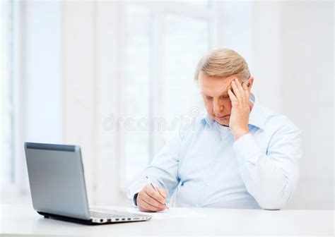 Old Man Filling A Form At Home Stock Image  Image 35224841