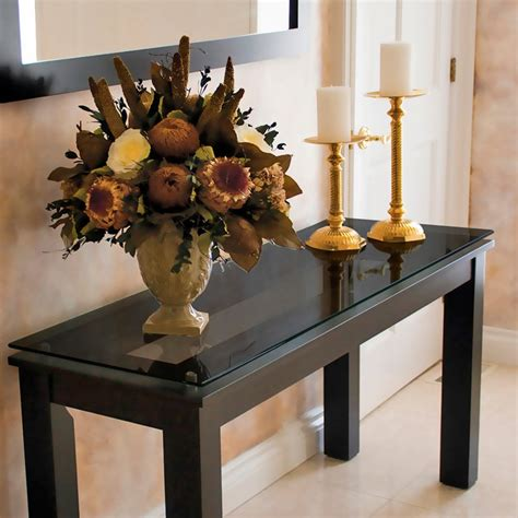 how to decorate a sofa table against a wall long wood rectangle console table with black glass top and