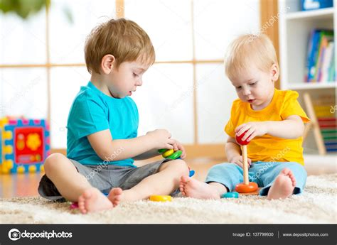 children play with educational toys in preschool or 794   depositphotos 137799930 stock photo children play with educational toys