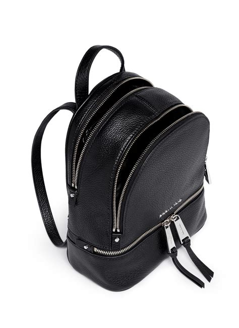 lyst michael kors rhea extra small leather backpack  black