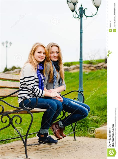 Two Happy Teen Girls Friends Having Fun Outdoors Stock