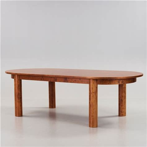 a stained birch dining room set with a table and twelve
