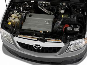 Image  2009 Mazda Tribute Fwd I4 Hybrid Touring Engine