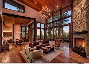 Rustic Living Room with High ceiling & stone fireplace in