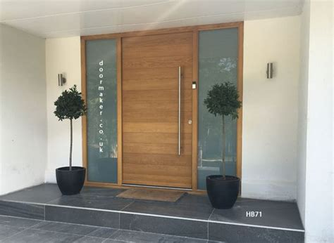 contemporary oak door with sandblast sidelights gates or