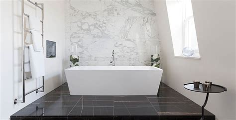 a timeless marble feature wall with a modern bath tub