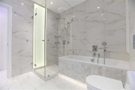 ideas for renovating small bathrooms wood floors white cabinets bathrooms with