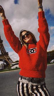 This Chanel red sweater with logo is all over Instagram