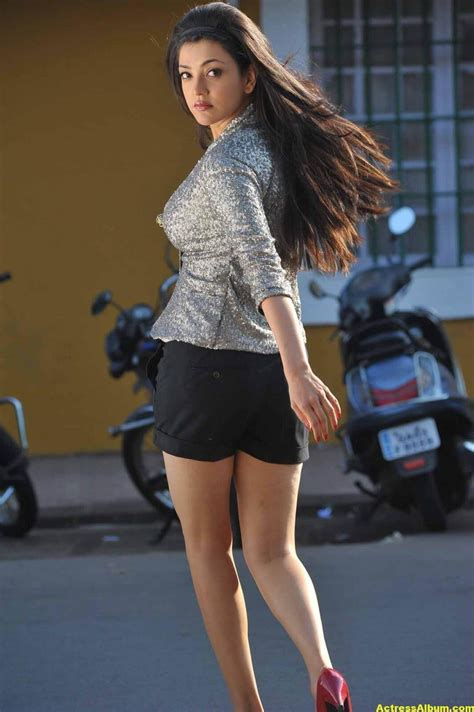 actress kajal agarwal long legs  mini black dress