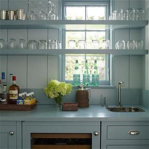 navy wet bar cabinets  wood countertops  stainless