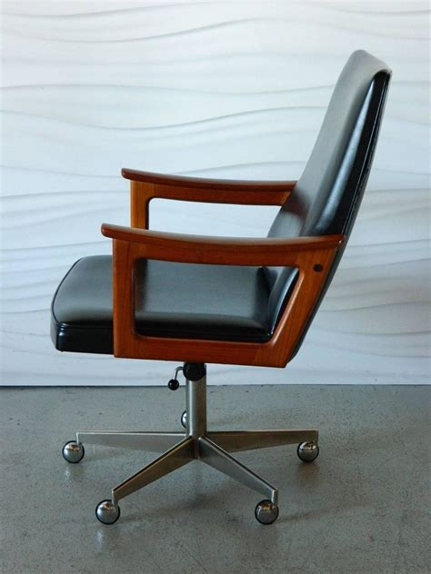 mid century modern teak desk chair in the style of
