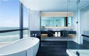 20 hotel bathrooms that will have you spending vacation in for Putting a tv in the bathroom