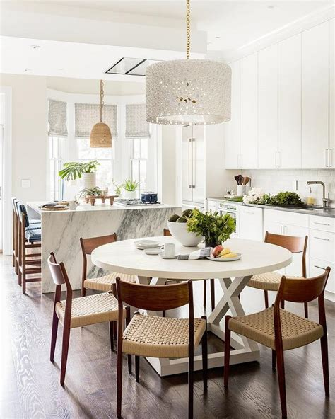 white drum chandelier   white dining table