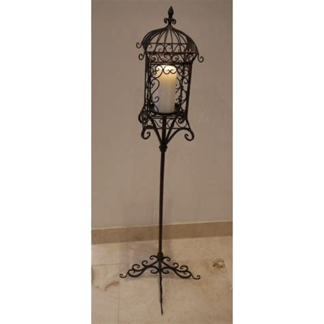 tall candle holder iron lantern  stand swanky interiors