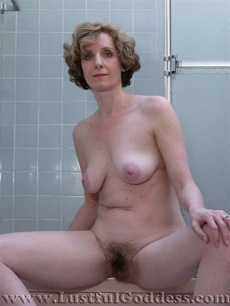Lustful Goddess: Mature pretty blond Bess in the bathroom