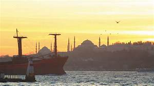 Cargo Ship Cruising In Front Of Old Istanbul On Sunset ...