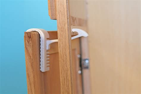 child proof cabinet doors rimiclip a new kind of painless child safety latch