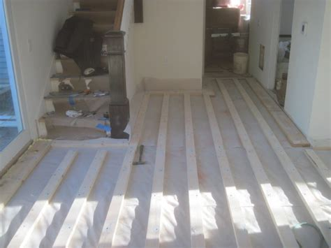 installing wood floor concrete how to install engineered wood over concrete howtos diy plywood subfloor over concrete in
