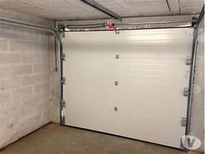 Porte de garage sectionnelle motorisee pas chere for Porte de garage sectionnelle non motorisée