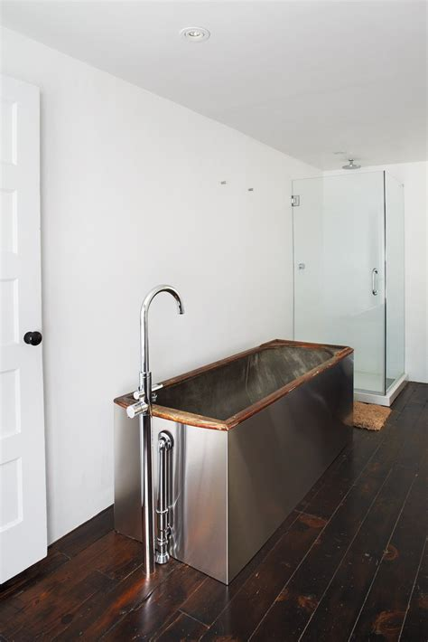 freestanding corner tub photo 4 of 12 in floats dwell