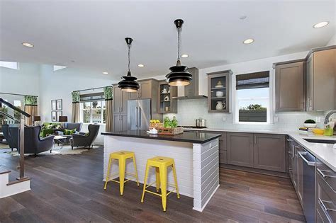 Gray Kitchen With Yellow Stools