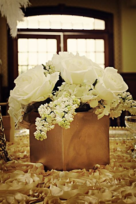 gold  ivory wedding centerpieces