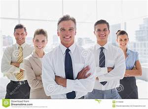 Smiling Business People With Arms Crossed In Their Office ...