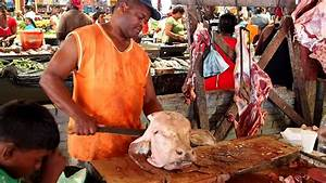 Butchering A Cow Head With A Machete In Guyana