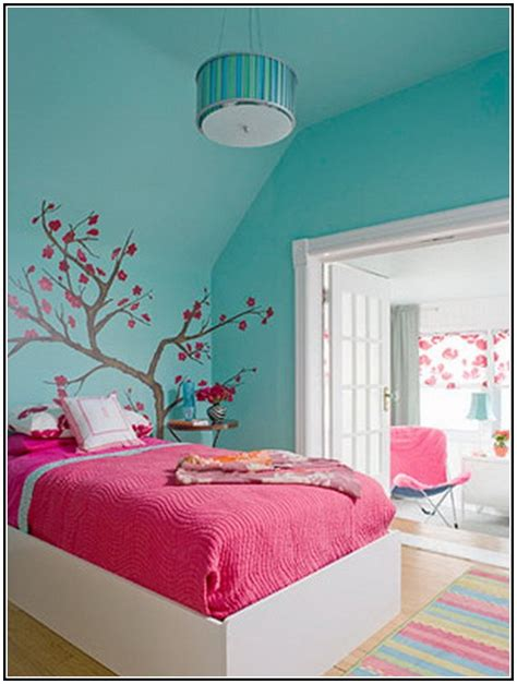 bedroom colors pink bedroom color combinations pink psoriasisguru com 10360 | Blue wall paint color with beautiful wall art white bed with deep pink bed linen and white pillows multi colors bedroom rug with strips pattern wood floors blue pendant lamp