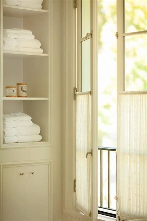 white casement cabinet  indigo blue art transitional entrancefoyer